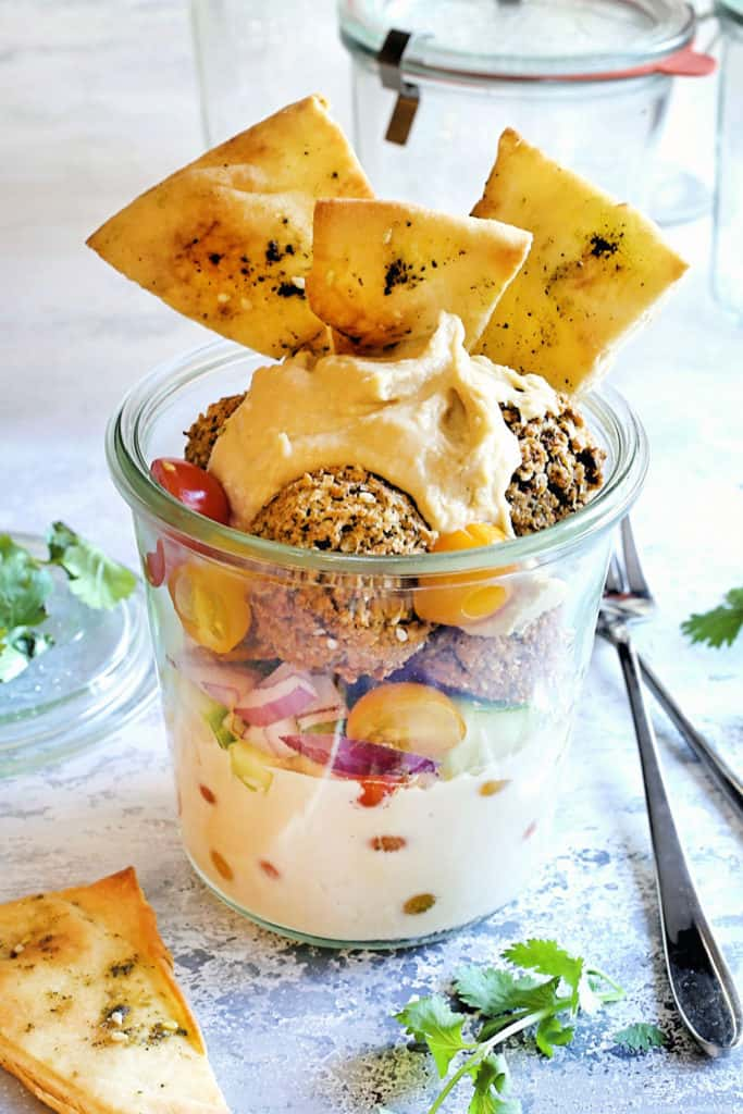 falafel salad in a jar with toasted pitas