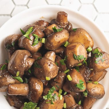 sauteed mushrooms in bowl on tile counter