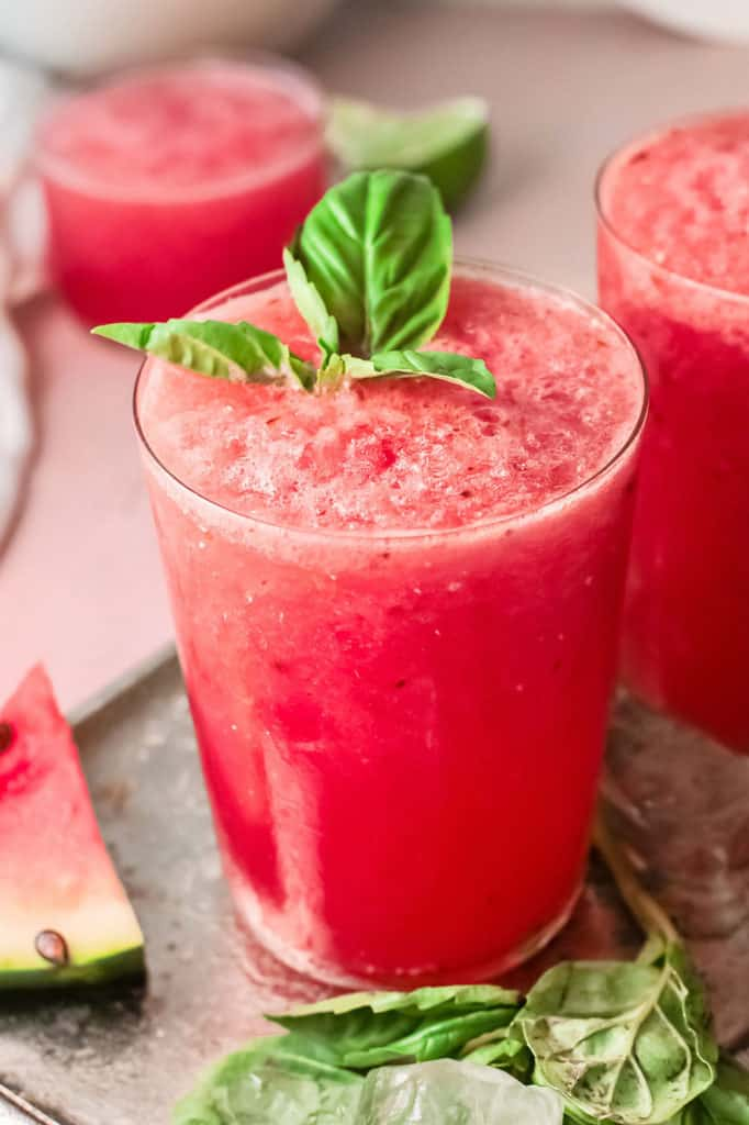 watermelon wine slushie on tray with ice and basil