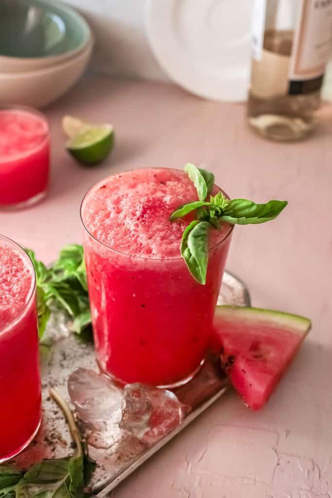 watermelon wine slushie on table wtih wedge o watermelon
