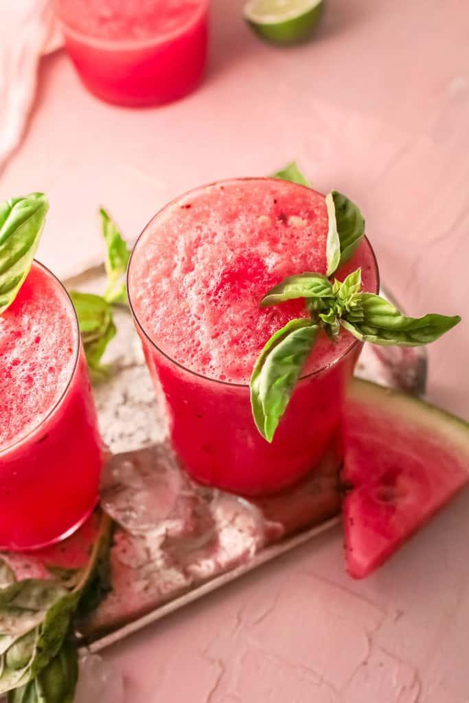 watermelon wine slushie with wedge of watermelon and ice