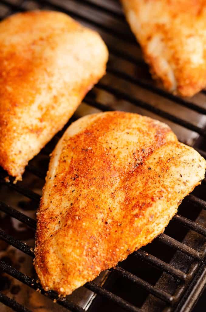 chicken breast on smoker grill