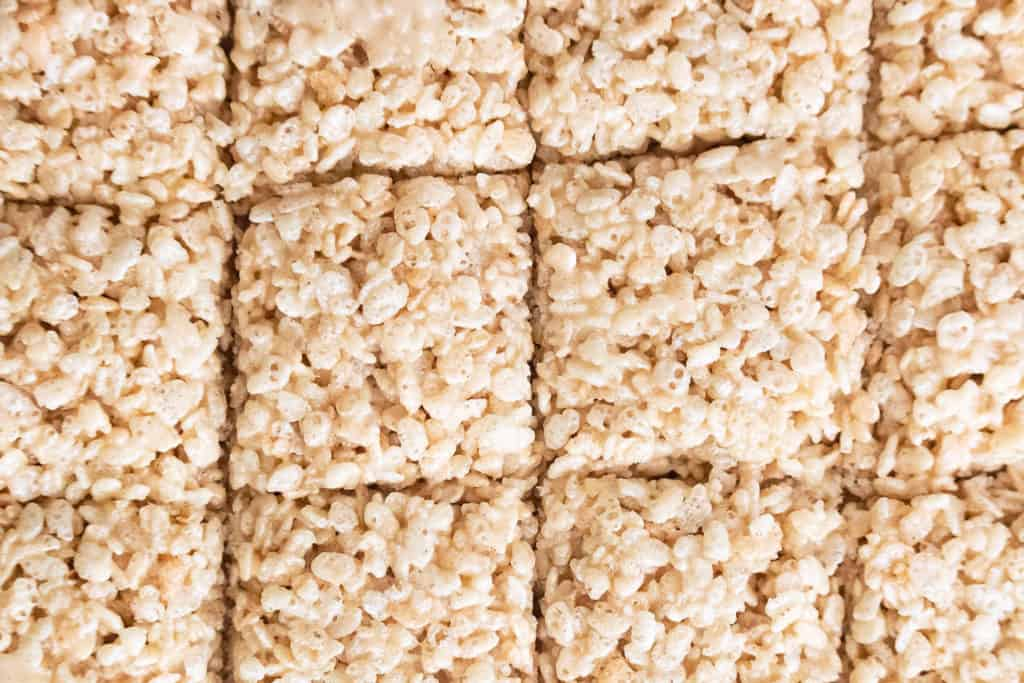 brown butter rice krispie treats cut into squares in the pan