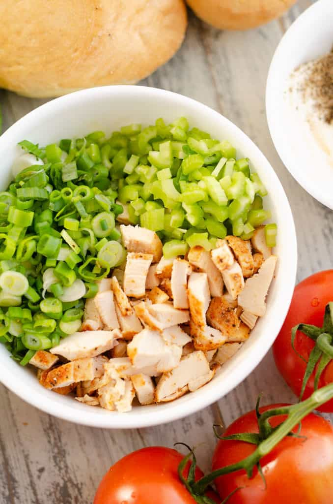 white bowl with diced smoked chicken, green onion and celery