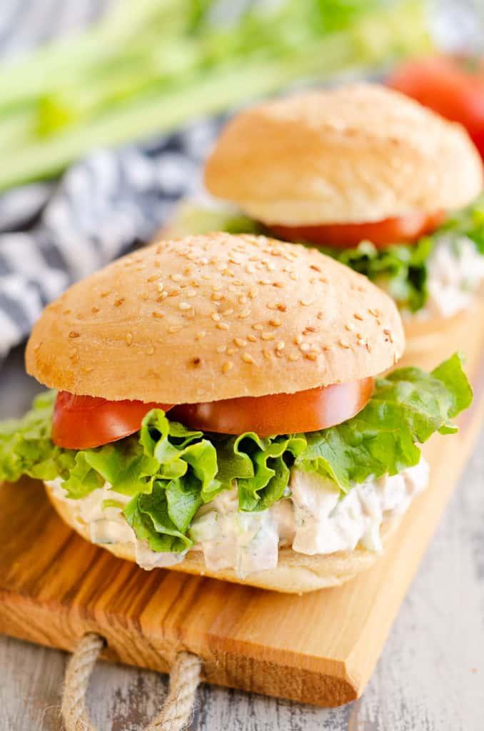 chicken salad sandwiches on wooden tray