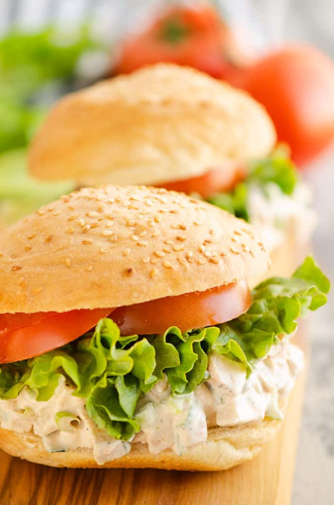 smoked chicken salad on sesame buns with lettuce and tomatop