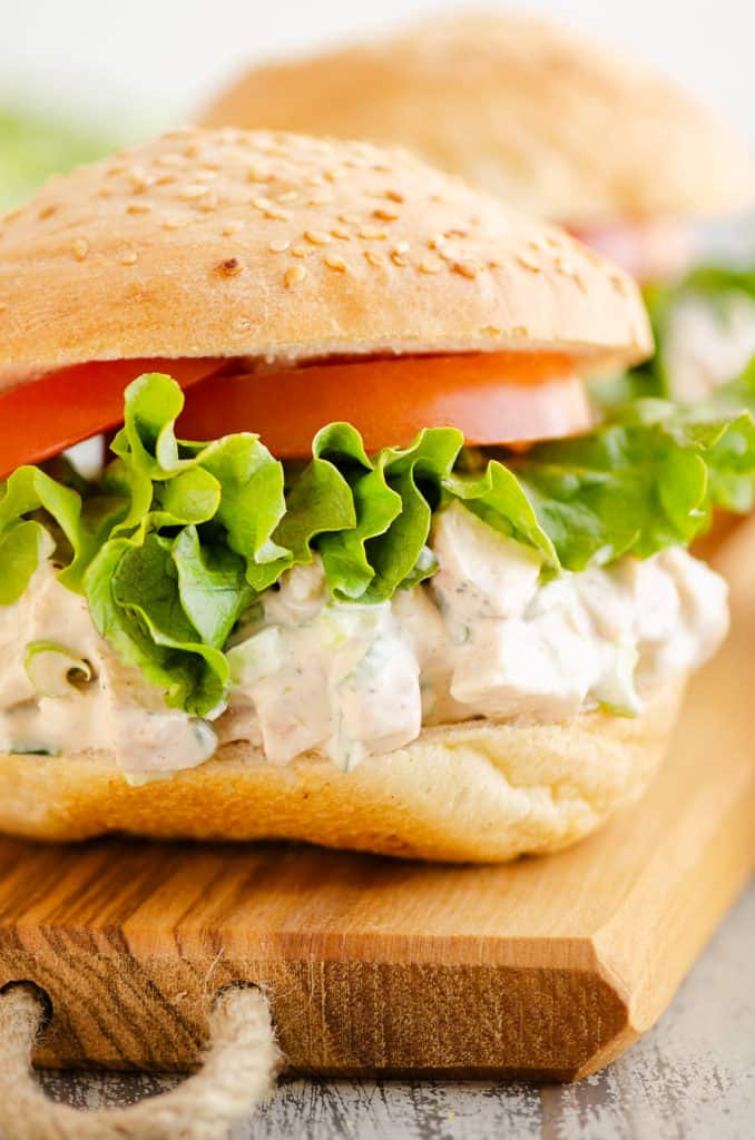 smoked chicken salad sandwich on wooden tray
