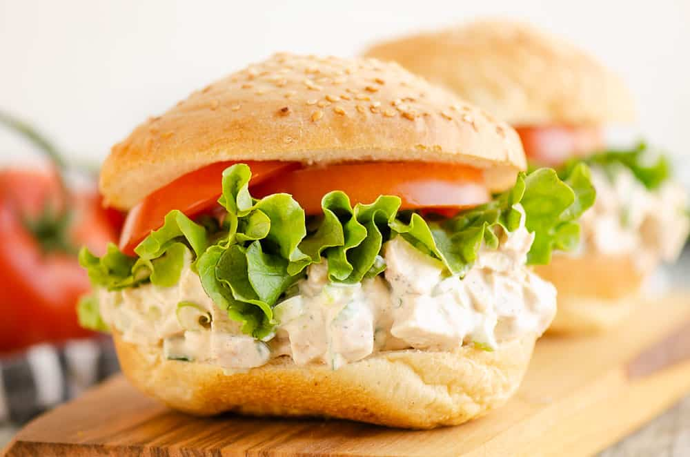 smoked chicken salad piled on sesame bun with lettuce and tomato