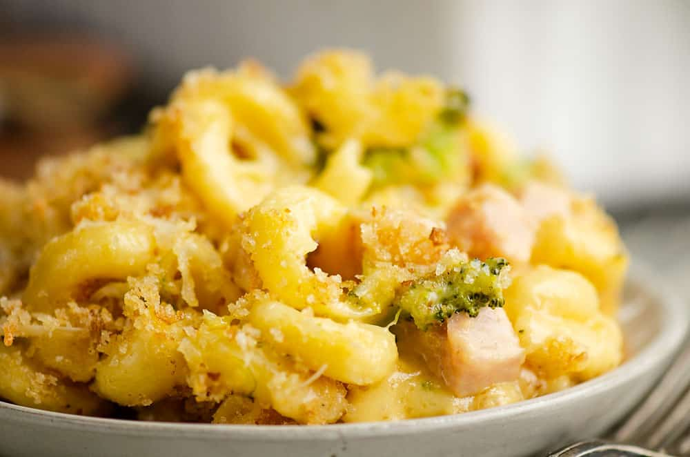 mac and cheese with broccoli and ham on plate with fork