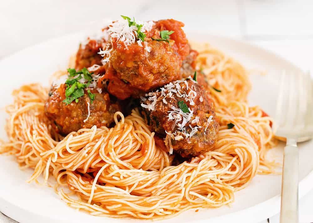 air fryer meatballs over pasta on plate