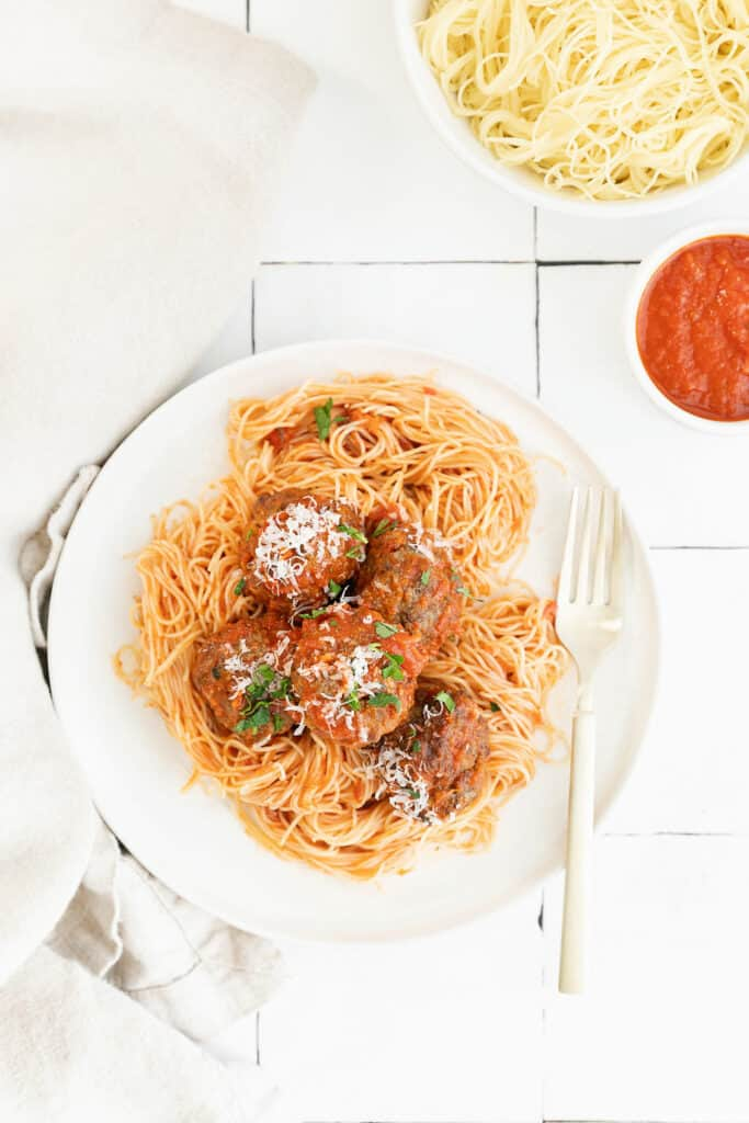 spaghetti and air fryer meatballs on white plate