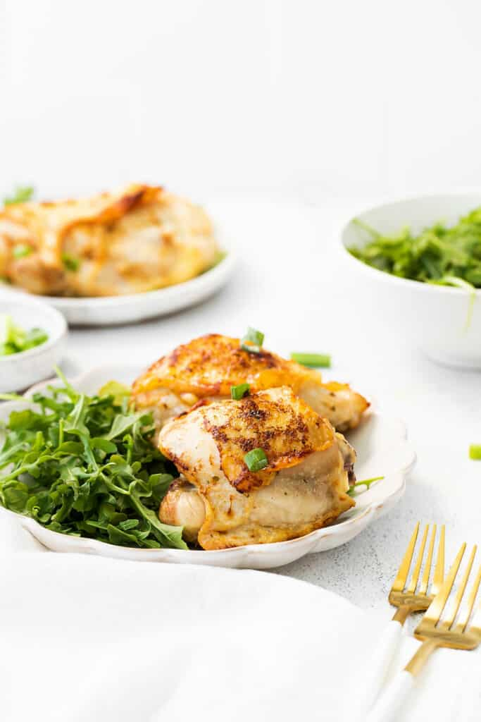 ranch chicken thighs on plate with salad