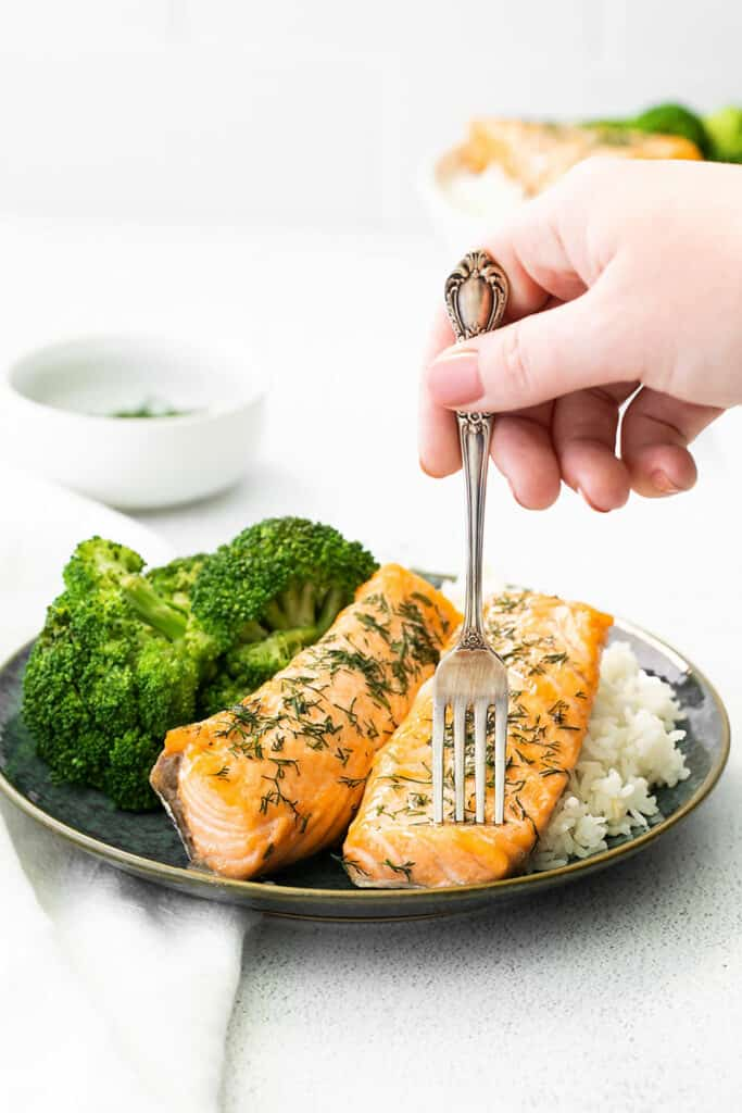 fork taking bite out of air fryer salmon fillets