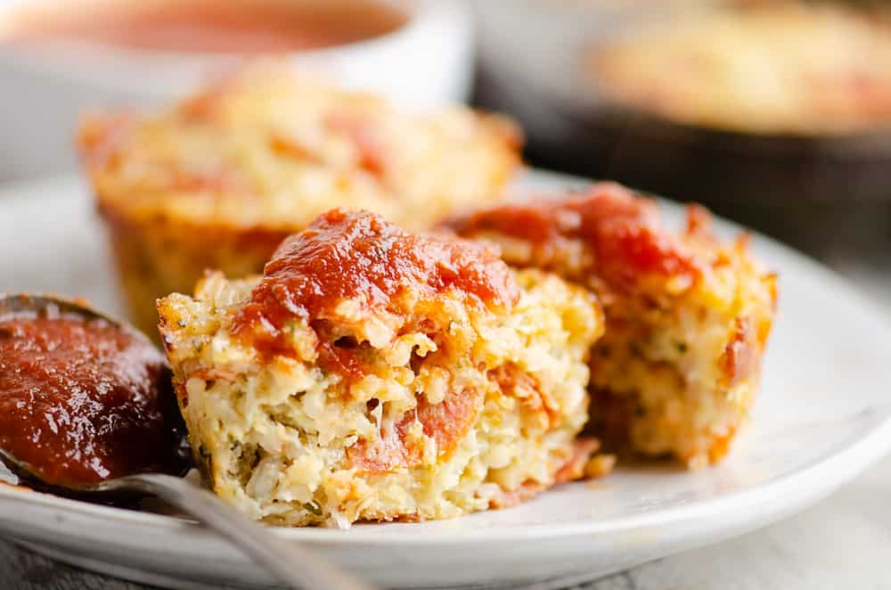 sliced pizza rice muffin topped with pizza sauce
