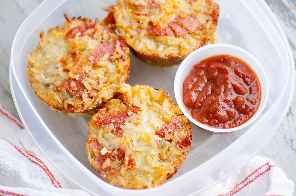 leftover pizza rice muffins stored in tupperware container with pizza sauce