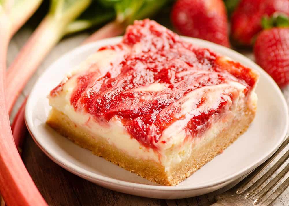 strawberry rhubarb cheesecake bar served on plate