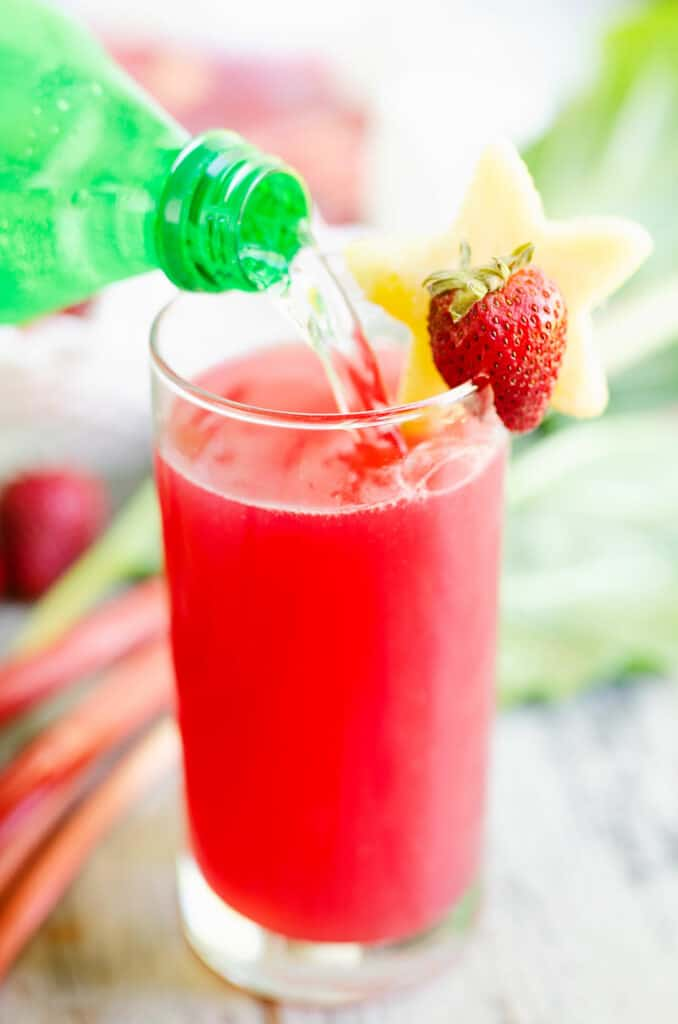 lemon lime soda poured over strawberry rhubarb juice
