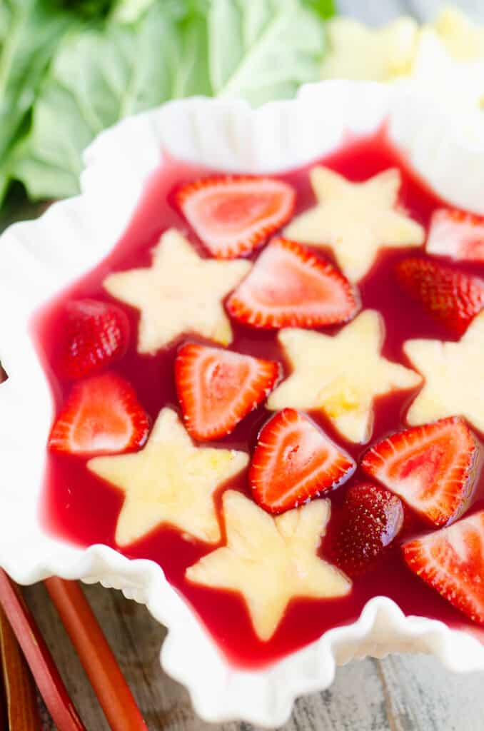 strawberry rhubarb punch in bowl with fresh fruit
