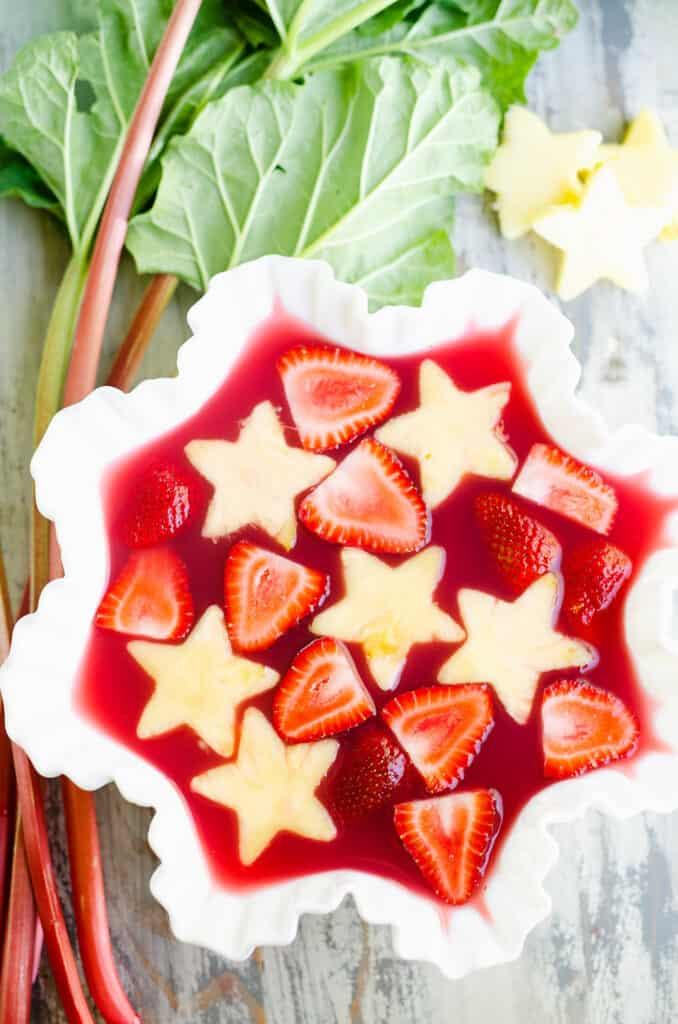 strawberry rhubarb punch in bowl with fresh pineapple stars