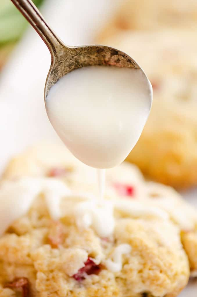 vanilla icing drizzled over rhubarb scone