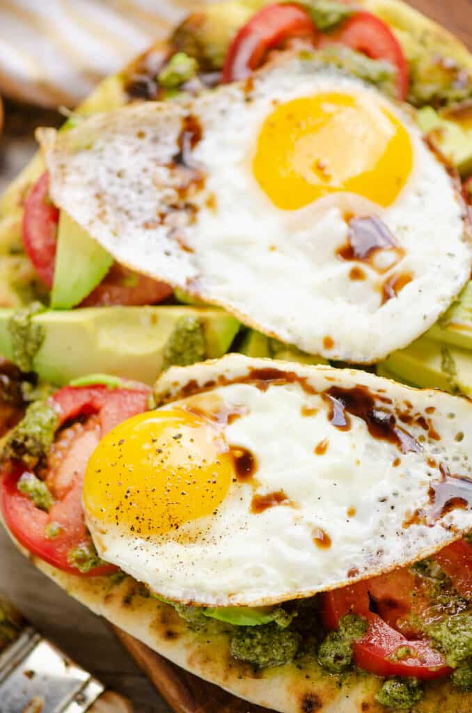caprese flatbread topped with eggs