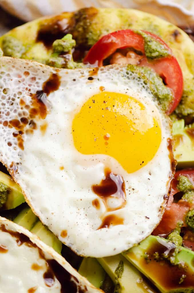 sunny side up egg drizzled with balsamic over flatbread