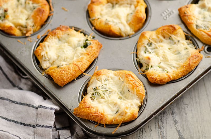 chicken broccoli crescent cups in muffin tin on table