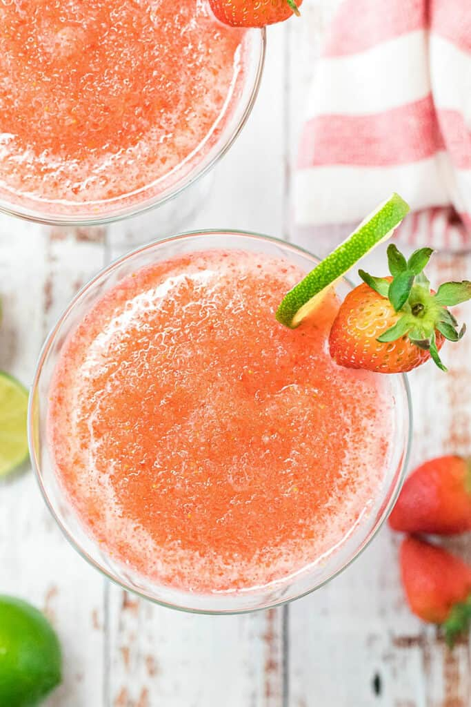 frozen daiquiri in glass with lime wedge