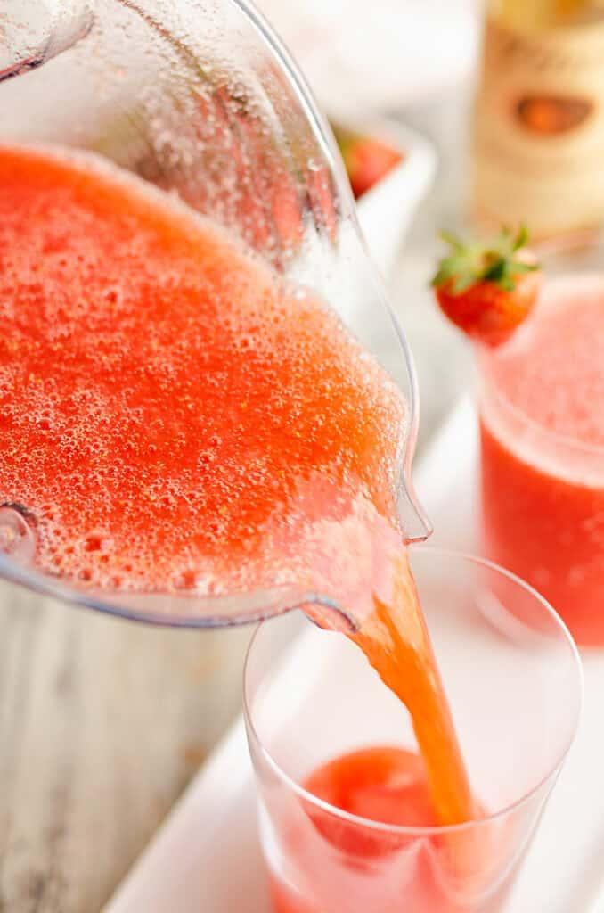 strawberry lemonade vodka slush poured in glass
