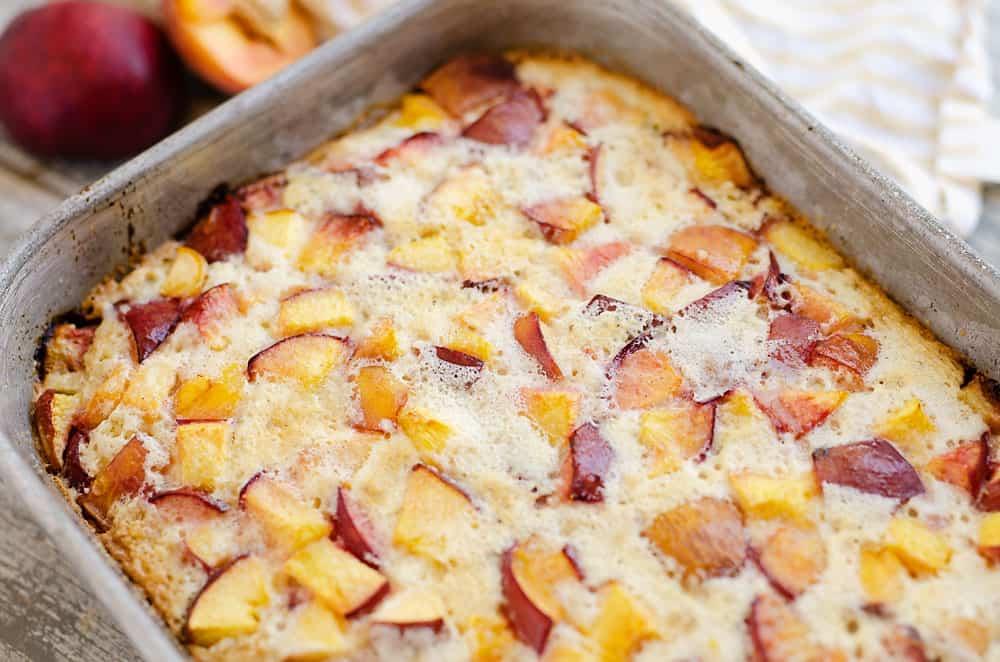 peach custard dessert in 9x13 pan
