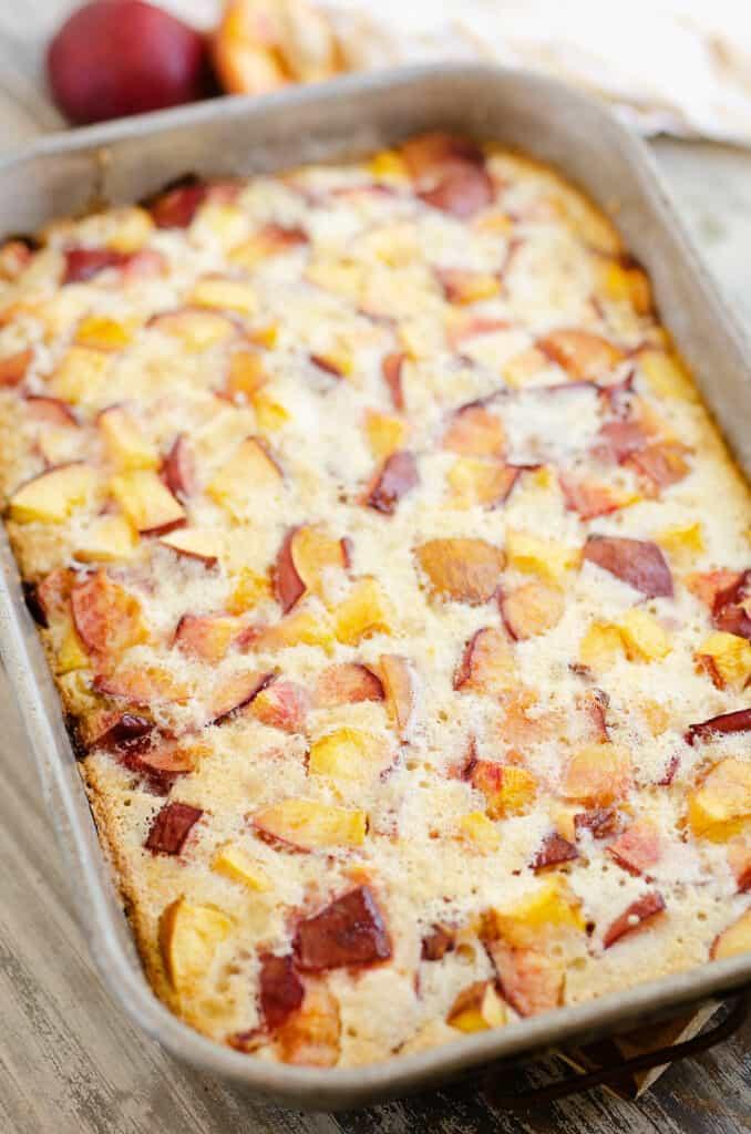 peach custard dessert in pan