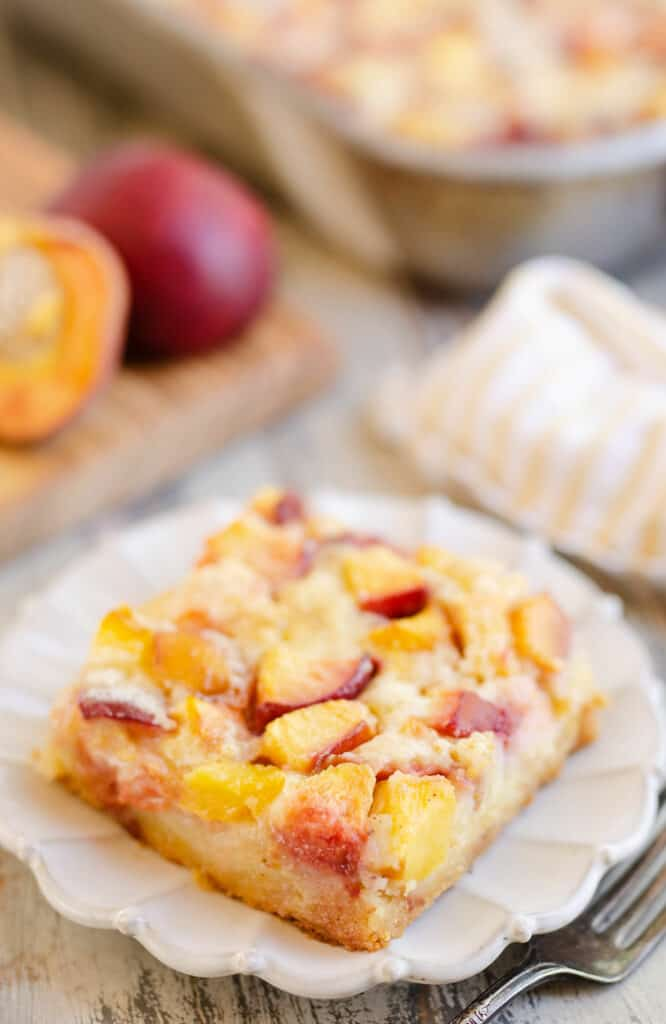 slice of peach custard dessert on table