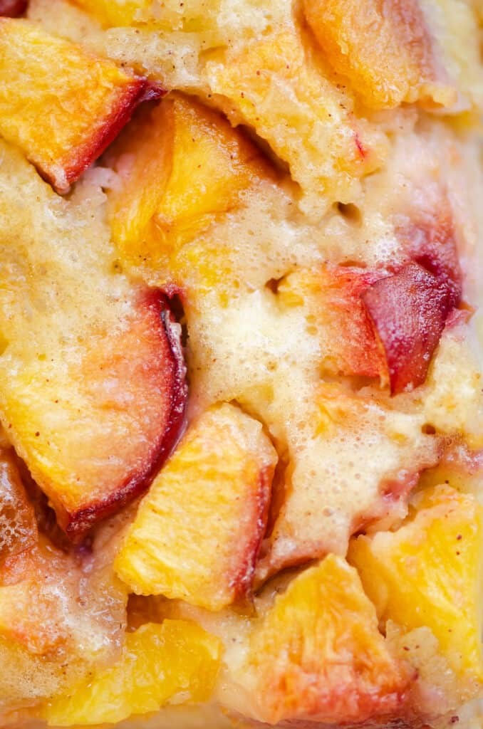 sliced peaches with skins in custard