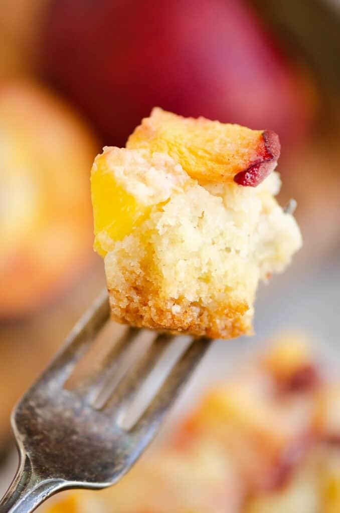 bite of peach custard dessert on fork