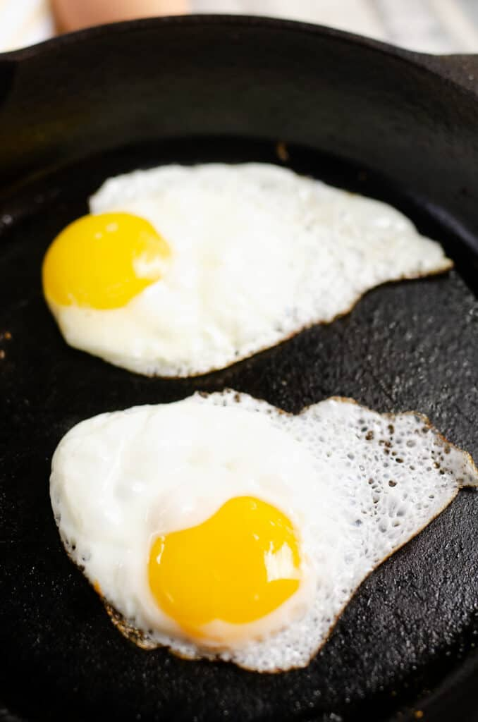 two egg fried in cast iron skillet