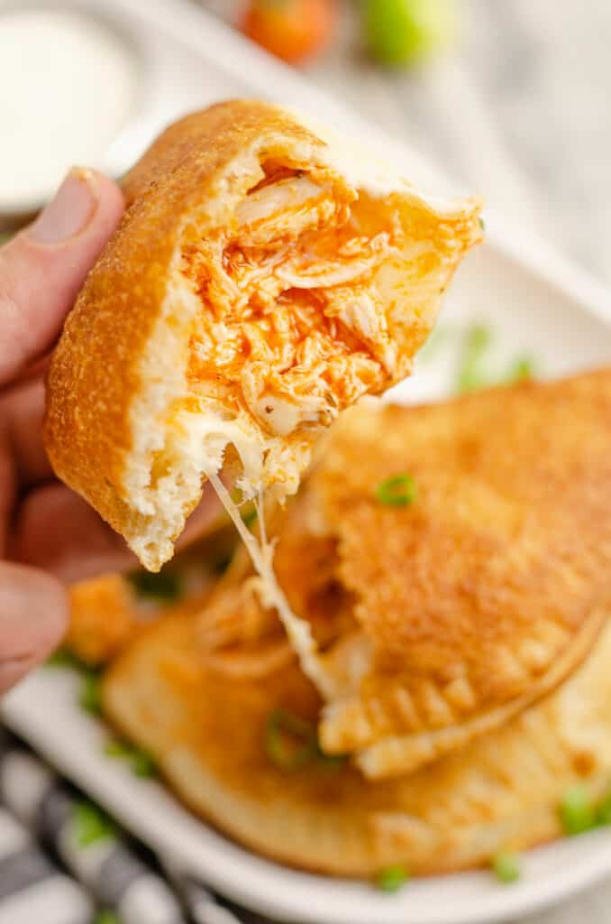 cheesy buffalo chicken calzone pulled apart