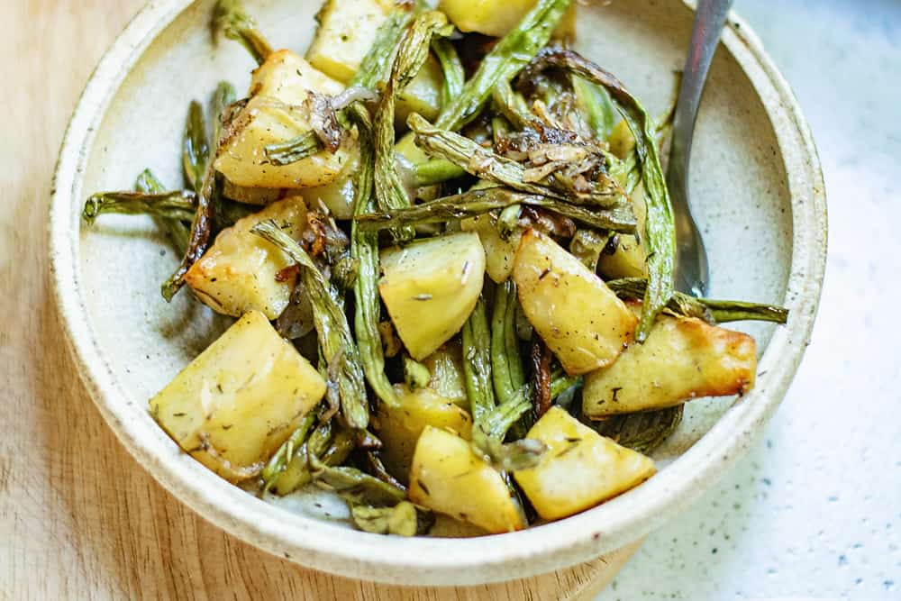 roasted green beans and potatoes on plate