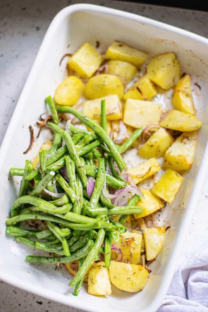 green beans, shallots and potatoes in baking dish