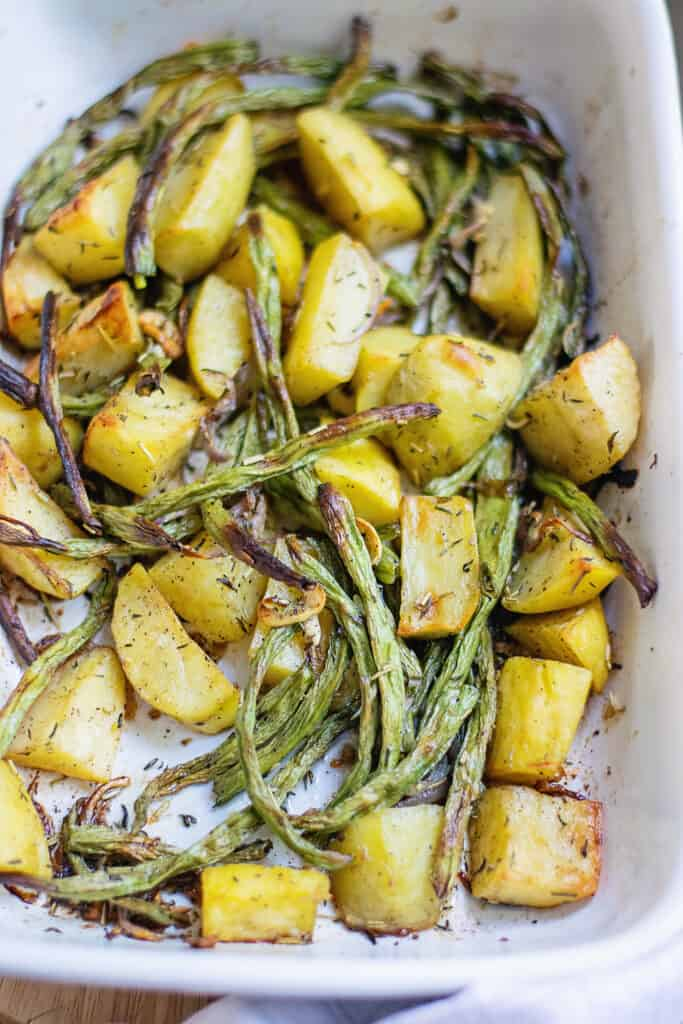 roasted green beans and potatoes in baking dish