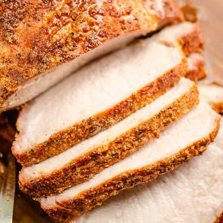 pork loin sliced on cutting board