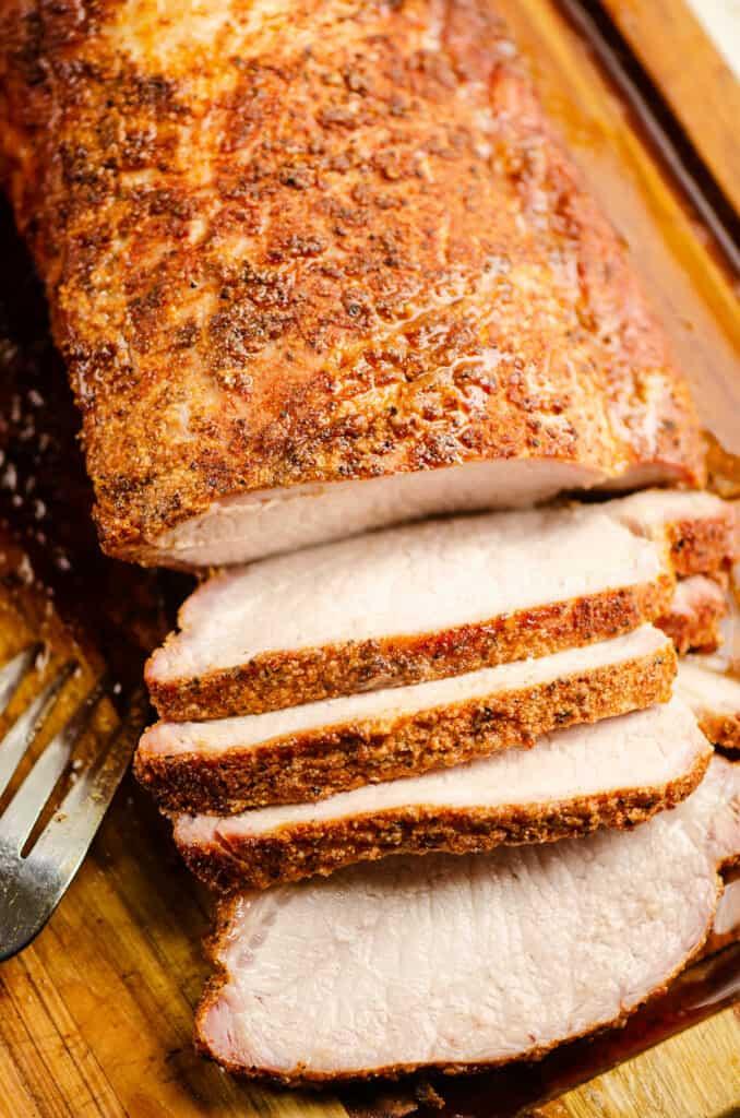 smoked pork loin sliced on cutting board