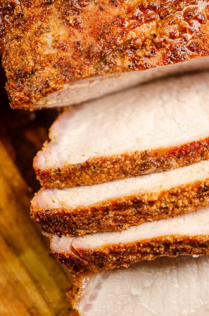 sliced of pork loin on cutting board