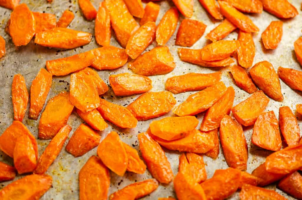carrots roasted with honey and olive oil on pan
