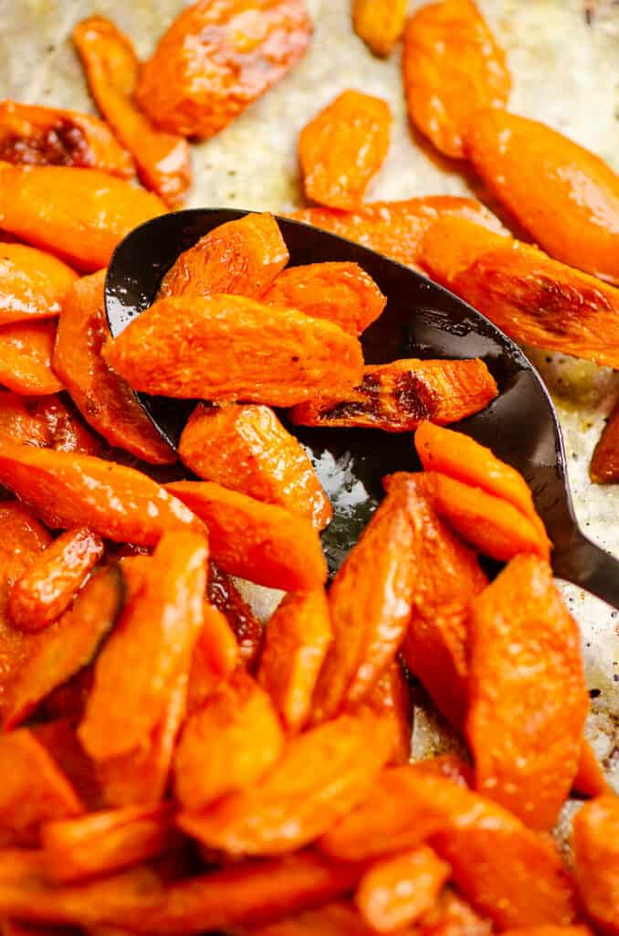 spoon scooping oven roasted carrots