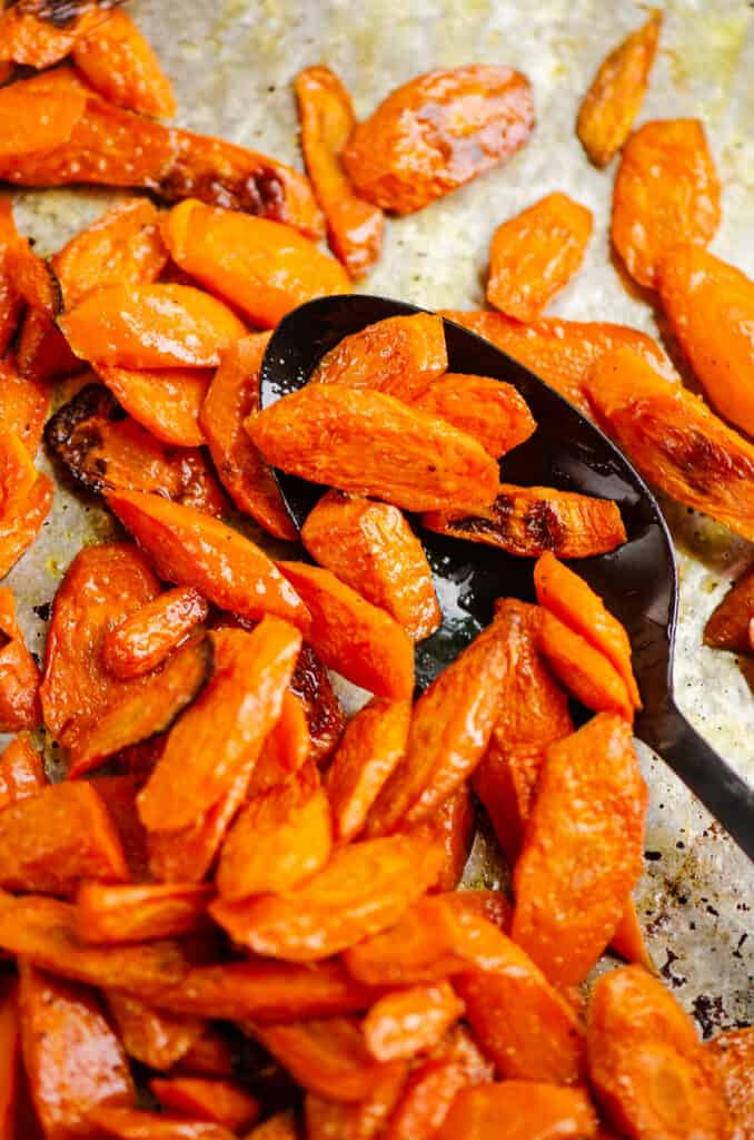 oven roasted carrots on serving spoon