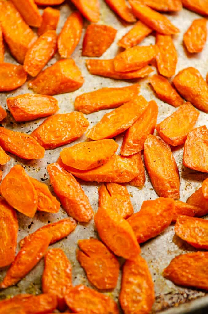 carrots roasted with salt and pepper on baking sheet