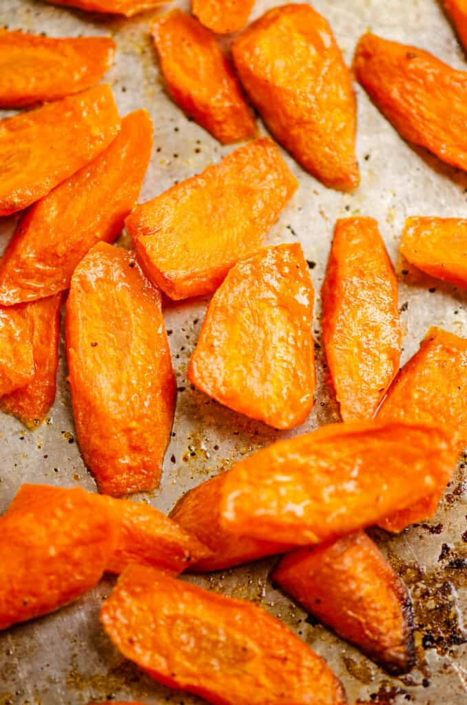 roasted carrot slices on baking sheet
