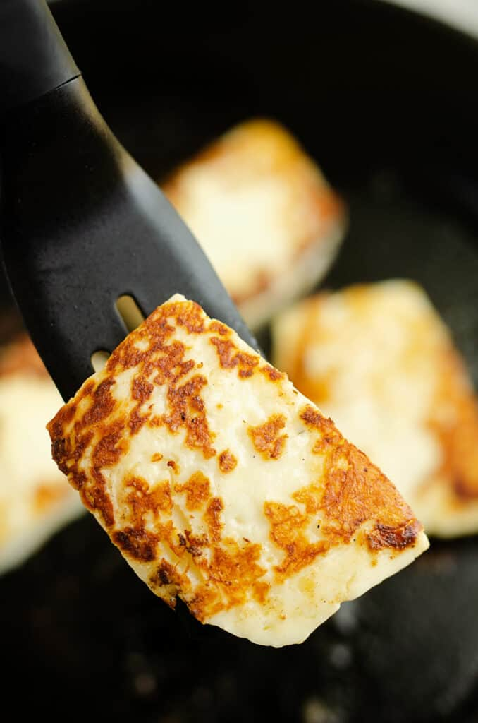 grilled halloumi cheese on spatula