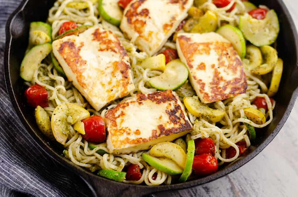 grilled halloumi cheese and vegetable pasta in pan