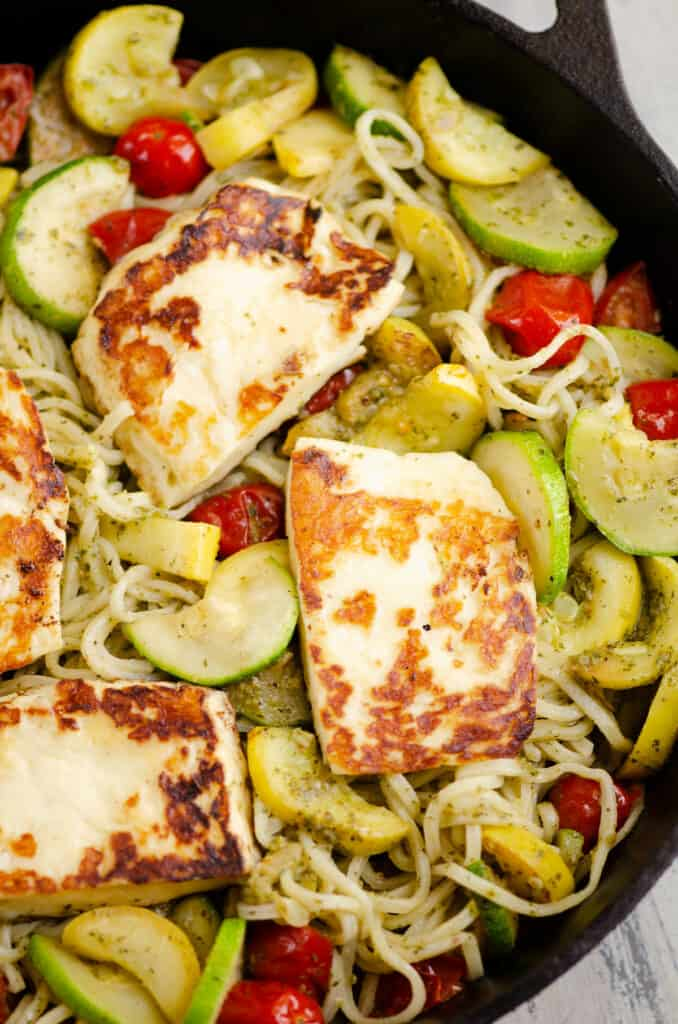 grilled halloumi cheese and pesto pasta in pan